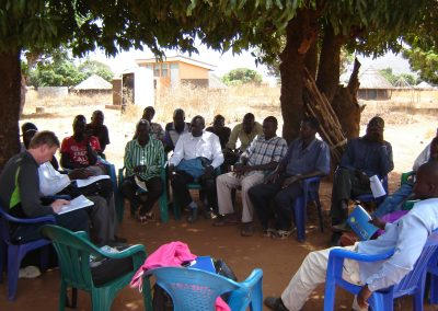 Community discussion in northern Uganda